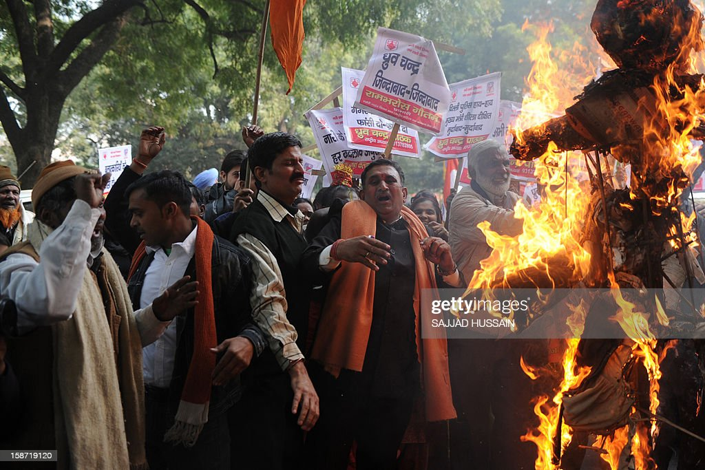 Demonstrators burn an effigy representing rapists during a protest calling for better safety for women following the rape of a student in the Indian capital, in New Delhi on December 26, 2012. Protests across India over the last week against sex crimes have denounced the police and government, with the largest in New Delhi at the weekend prompting officers to cordon off areas around government buildings. One policeman was killed and more than 100 people injured in the violence. AFP PHOTO/SAJJAD HUSSAIN