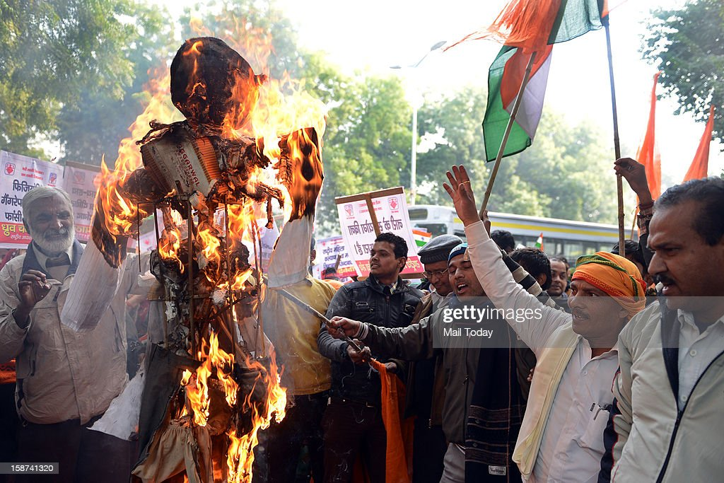 Demonstrators burn an effigy representing rapists during a protest calling for better safety for women following the rape of a student in the capital, in New Delhi on Wednesday.