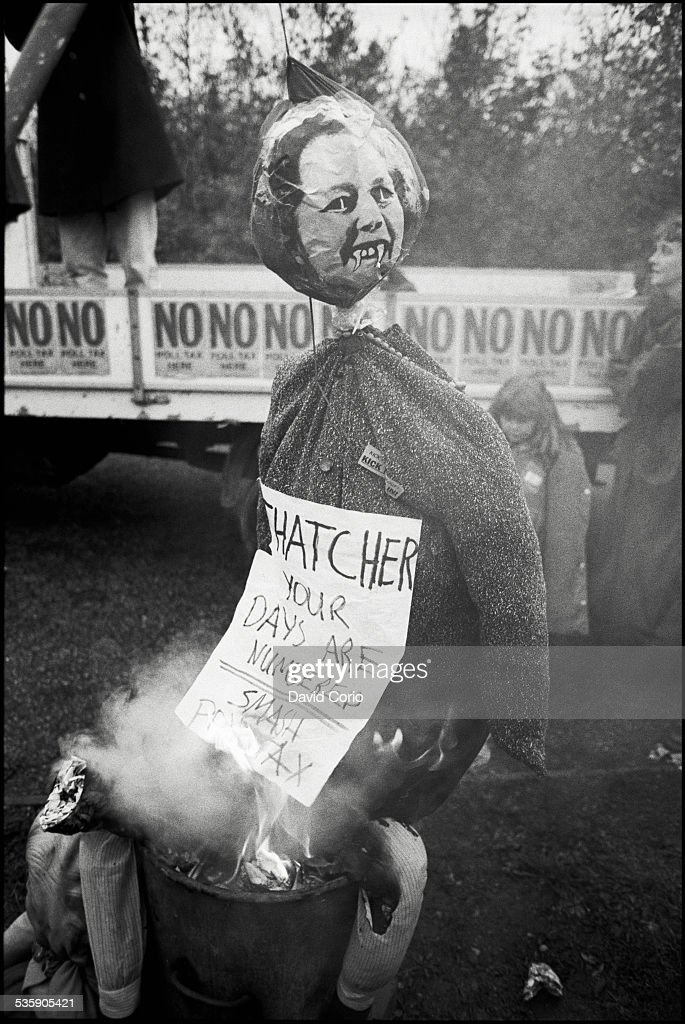 Demonstrators burn Poll Tax forms and a Margaret Thatcher effigy during a Poll Tax demonstration on Market Road, London, N7 , UK, 5th November 1989.