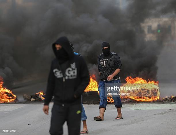 Demonstrators burn tires during a protest against the execution of prominent Shiite cleric Nimr alNimr by Saudi authorities in Manama Bahrain on...