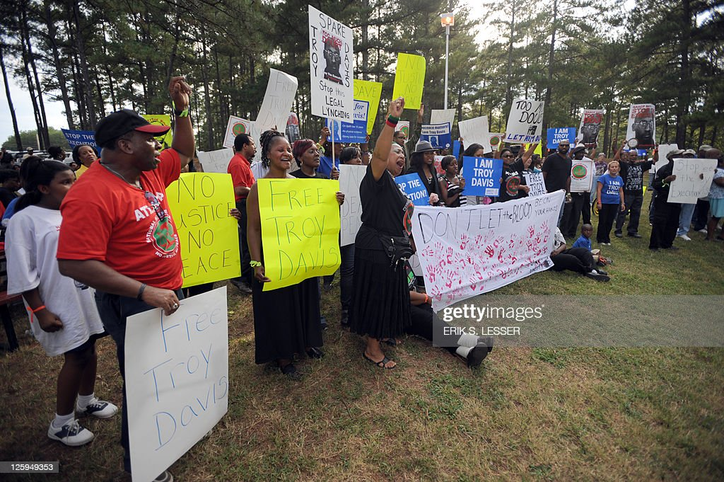 Demonstrators call for Georgia state officials to halt the scheduled execution of convicted cop killer Troy Davis at the Georgia Diagnostic and...