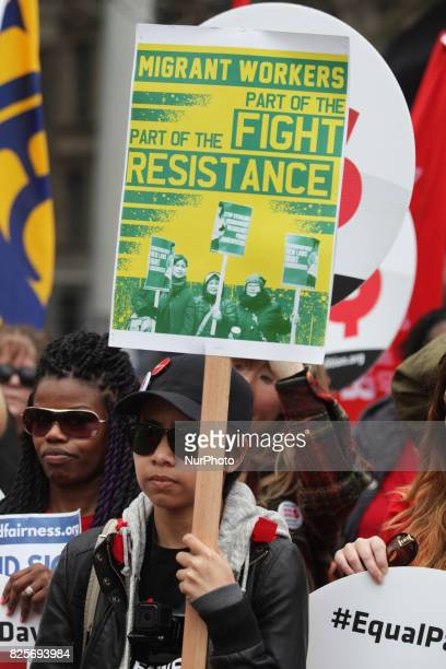 Demonstrators call for migrant workers rights as women rally to demand equal pay for women and an end to the wage gap between the sexes on 'Equal Pay...