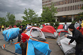 Demonstrators calling for an increase in the minimum wage to $15dollarsperhour pitch tents for an overnight protest outside of McDonald's corporate...