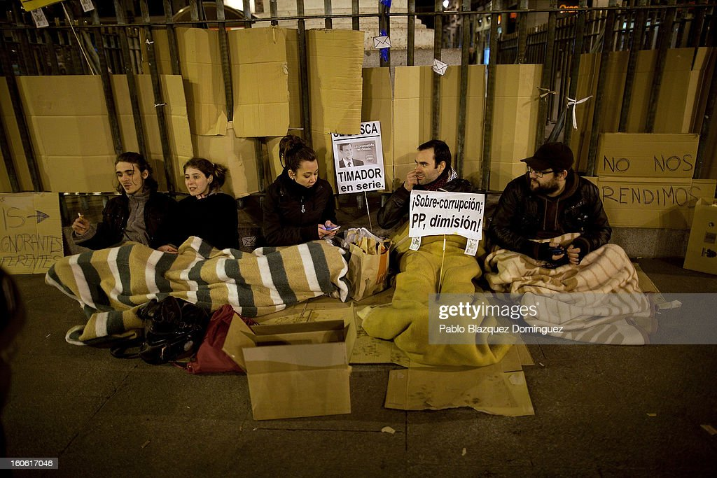 Demonstrators camp at a protest in Puerta del Sol Square after a demonstration against alleged corruption scandals implicating the PP (Popular Party) on February 3, 2013 in Madrid, Spain. Spain's Prime Minister Mariano Rajoy yesterday denied receiving undeclared payments from his political party. More information on secret payments were revealed today and leader of opposition socialist Party (PSOE) urged Rajoy to resign.