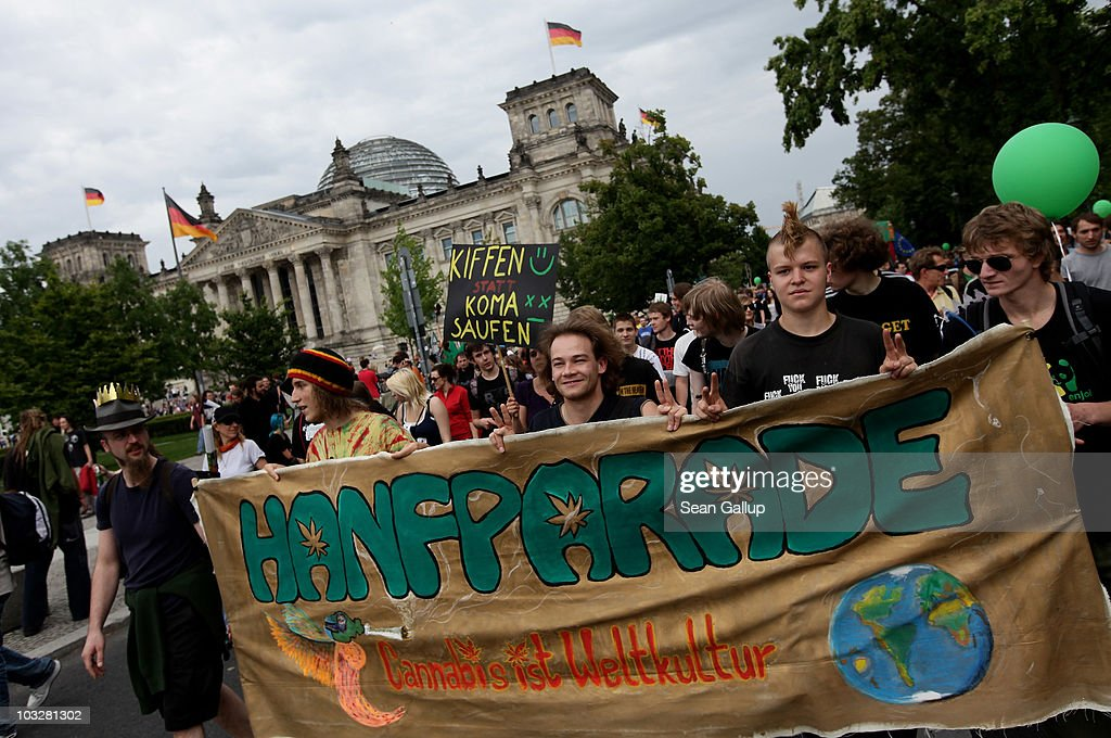 'Hemp Parade - Cannabis Is World Culture' while marching past the Reichstag in support of the legalization of marijuana in Germany during the annual Hemp Parade, or 'Hanfparade', on August 7, 2010 in Berlin, Germany. The consumption of cannabis in Germany is legal, though all other aspects, including growing, importing and selling it, are not. However, since the introduction of a new law in 2009, the sale and possession of marijuana for licenced medicinal use is legal.
