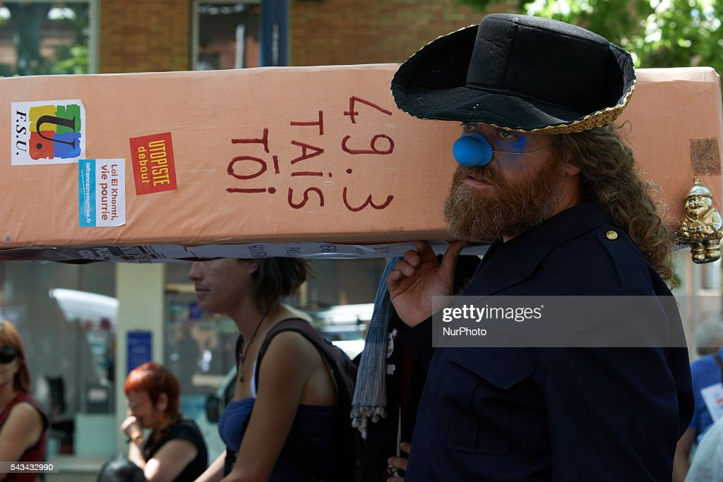 Demonstrators carry a false coffin symbolizing Democracy with the words '49.3 shut up' during a demonstration against the El-Khomri bill on labour reforms. They also protest against the use of article 49.3 which bypass the Parliament . Toulouse. France. June 28th, 2016.