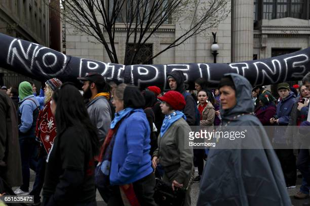 Demonstrators carry a 'No Pipeline' snake during a protest against the Dakota Access Pipeline in Washington DC US on Friday March 10 2017 The...