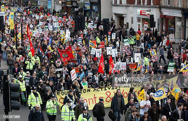 Demonstrators carry banners as they march during a one day publicsector workers strike in London UK on Wednesday Nov 30 2011 Members of 30...