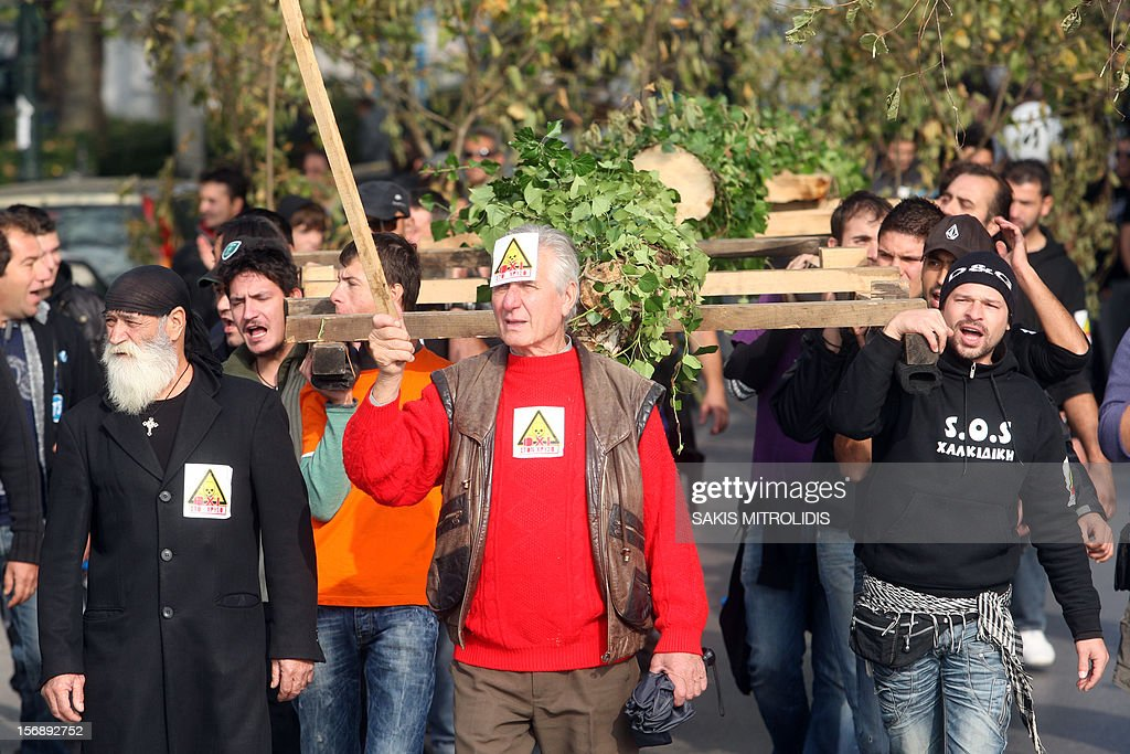Demonstrators, carrying cut trees, march in Thessaloniki on 24 November, 2012 against efforts by Hellas, a subsidiary of the Canadian firm Eldorado Gold, to mine the Skouries quarry on Mount Kakkavos, in the Halkidiki peninsula in northern Greece. Eldorado Gold says it plans to plough around one billion euros (1.2 billion US dollars) into the mines of Halkidiki, which have been producing lead, zinc and silver for decades.