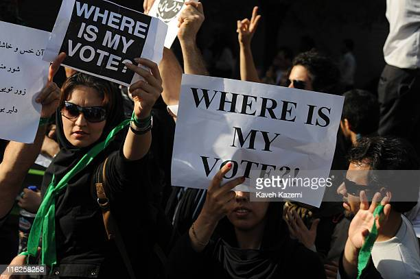Demonstrators carrying 'Where Is My Vote' posters march on Karimkhan Street Tehran 17th June 2009 Many are wearing green ribbons in support of the...