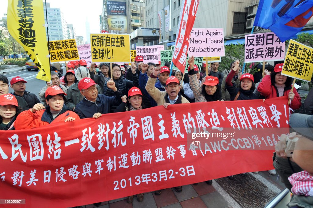 Demonstrators chant anti-US slogans and display banners during a protest in Taipei on March 4, 2013. Over 100 right-wing activists from Taiwan and five other nations demonstrated on March 4 at the de facto US embassy in Taipei urging a US military withdrawal from the Asia Pacific region. AFP PHOTO / Mandy CHENG