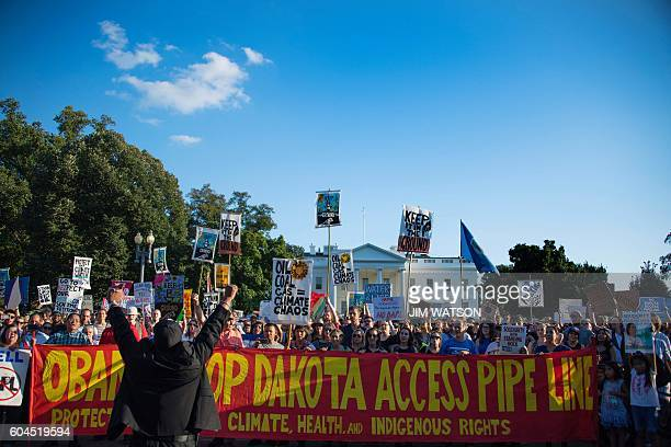 Demonstrators chant as they gather in front of the White House in Washington DC September 13 to protest the Dakota Access Pipeline The US government...