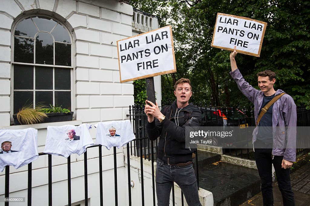 Demonstrators chant as they wave placards with the words 'Liar Liar Pants On Fire' written on them outside the home of former London Mayor Boris Johnson on July 1, 2016 in London, England. Mr Johnson backed out of the Conservative Leadership contest yesterday after his ally and supporter Justice Secretary Michael Gove announced he too would run. Home Secretary Theresa May is now leading the race to head the Conservative Party that could lead to becoming Prime Minister.