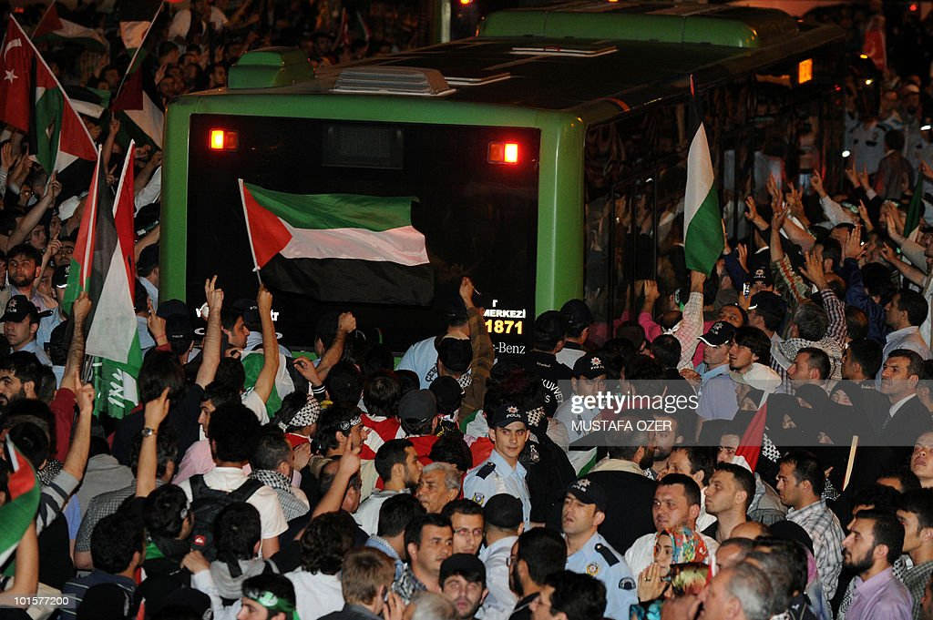 Demonstrators chant slogans and waves Palestinian flags as they welcome Turkish activists expelled from Israel, at Istanbul's airport on June 3, 2010. Hundreds of activists from the Gaza-bound aid flotilla seized by Israeli commandos arrived in Turkey, as Israel's prime minister denounced some of them as 'violent supporters of terrorism.' A crowd of about a thousand people, some chanting anti-Israeli slogans, welcomed the three planes carrying 488 activists at Istanbul airport as they arrived in the small hours of the morning.