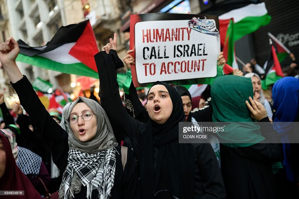 Demonstrators chant slogans during a rally on May 28, 2016 in Istanbul, to mark the 6th anniversary of 2010 Mavi Marmara flotilla incident, when Israeli naval commandos seized control of the Turkish ship Mavi Marmara, part of a flottila attempting to break the Gaza blocade, and resulting in the death of ten Turkish individuals. The crowd gathered in iconic istiklal avenue under the banner of the pro-Islamic Humanitarian Relief Foundation (IHH), one of the organisers of the flotilla that tried to break an Israeli sea blockade of the Hamas-controlled Palestinian territory. / AFP / OZAN