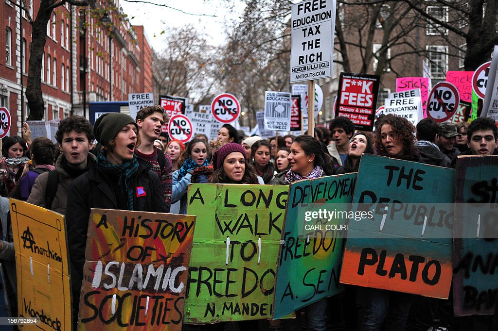 Demonstrators chant slogans during a student rally in central London on November 21, 2012 against sharp rises in university tuition fees, funding cuts and high youth unemployment. AFP PHOTO/CARL COURT