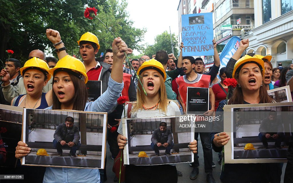 Demonstrators chant slogans on May 31, 2016 in Ankara during a demonstration commemorating the third anniversary of the start of the Gezi Park protests. The Gezi Park protests which began in May 2013, were sparked by the heavy-handed eviction of demonstrators staging a sit-in protest against the redevelopment of the area and grew into often violent clashes with police as people demonstrated against much broader issues concerning perceived infringements of civil rights. / AFP / ADEM
