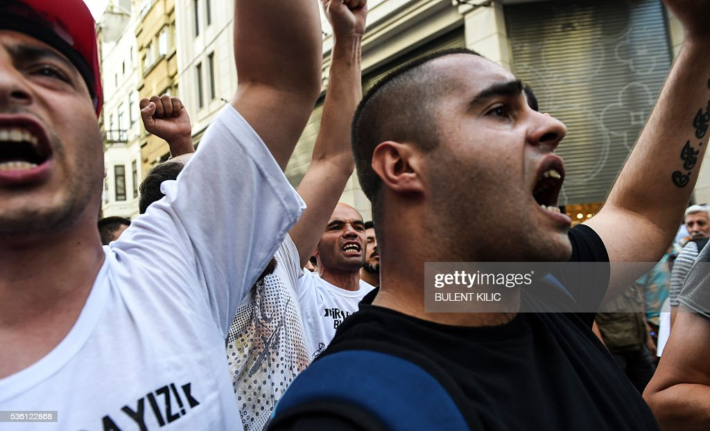 Demonstrators chant slogans on May 31, 2016 in Istanbul, on the third anniversary of the start of the Gezi Park protests. The Gezi Park protests which began in May 2013, were sparked by the heavy-handed eviction of demonstrators staging a sit-in protest against the redevelopment of the area and grew into often violent clashes with police as people demonstrated against much broader issues concerning perceived infringements of civil rights. / AFP / BULENT