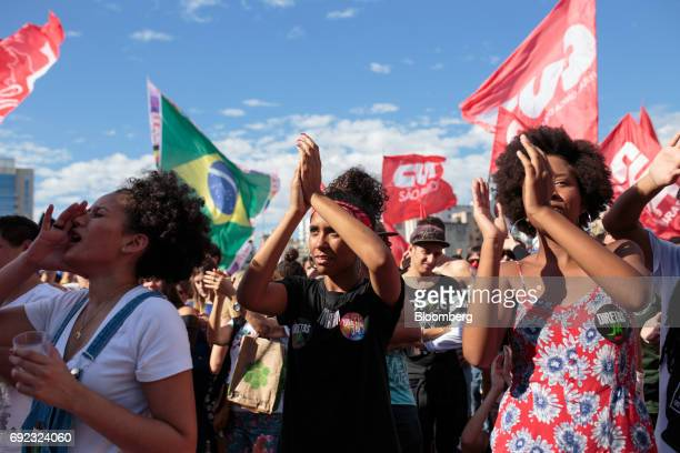 Demonstrators clap and chant during a protest against Brazilian President Michel Temer and government corruption at Largo da Batata in Sao Paulo...