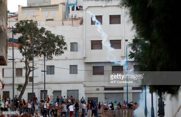Demonstrators clash with Moroccan security forces following a march in defiance of a government ban in the northern Moroccan city of alHoceima on...