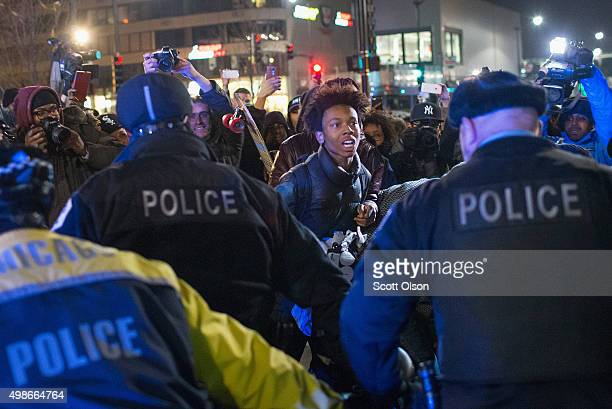 Demonstrators clash with police during a protest following the release of a video showing Chicago Police officer Jason Van Dyke shooting and killing...