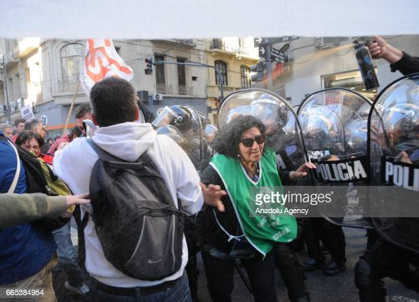 Demonstrators clash with policemen during the national CGT strike and the CTA against the economic policies of the government of Argentine President...