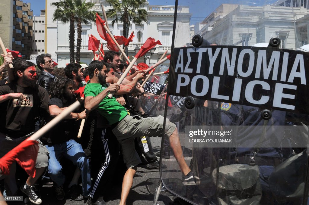 Demonstrators clash with policemen outside the greek Parliament during a Mayday demonstration on May 1, 2010, in Athens. Greek police fired tear gas on youths as marchers swarmed through central Athens to protest unprecedented austerity cuts needed for an EU and IMF loans worth as much as 120 billion euros. AFP PHOTO / Louisa Gouliamaki