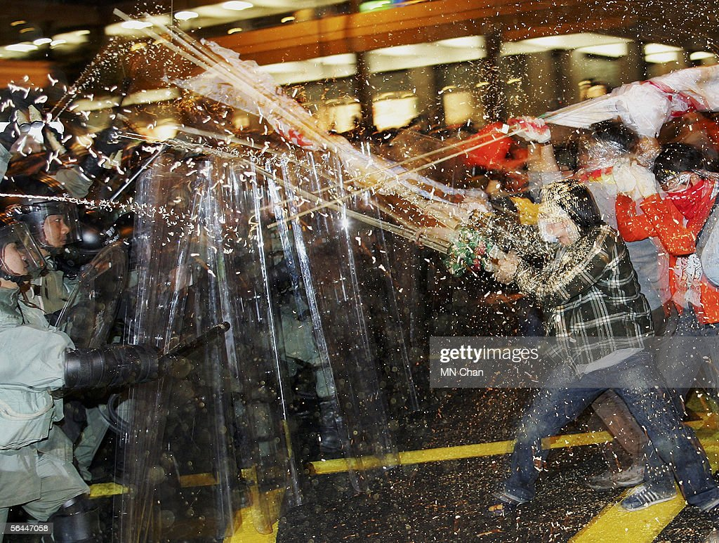 Demonstrators clash with riot police during a protest against the sixth World Trade Organization ministerial meeting December 17 2005 in Hong Kong...