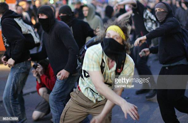 Demonstrators clash with riot police during May Day clashes in Kreuzberg on May 1 2009 in Berlin Germany Berlin police arrested 57 people in protests...