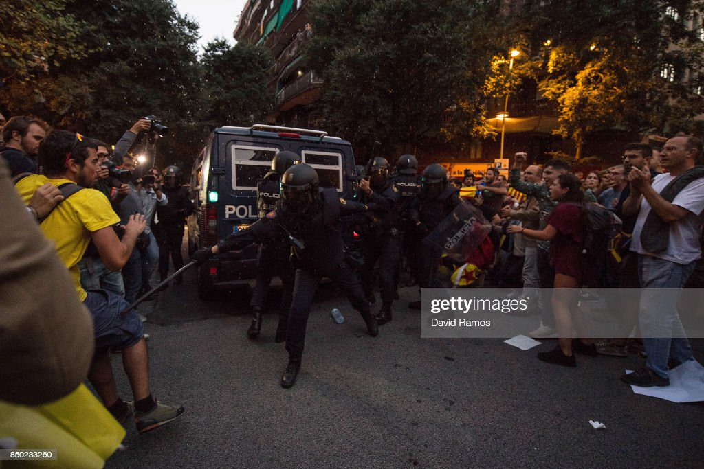 Demonstrators clash with Spanish National Police officers as they leave the road outside the Catalan Pro-Independence Lefty party CUP headquarters on September 20, 2017 in Barcelona, Spain. Spanish Civil Guard police have stormed several Catalan government ministries in an attempt to stop the region's independence referendum on October 1, which has been deemed illegal by the Spanish government in Madrid.