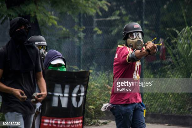 Demonstrators clash with the National Police during the six hour blocking in Caracas Venezuela 04 July 2017 The called quotNational blocking against...