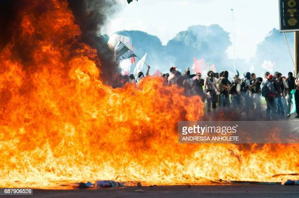 Demonstrators clash with the police during the protest 'Occupy Brasilia' against the labor and social security reforms of his government in Brasilia...