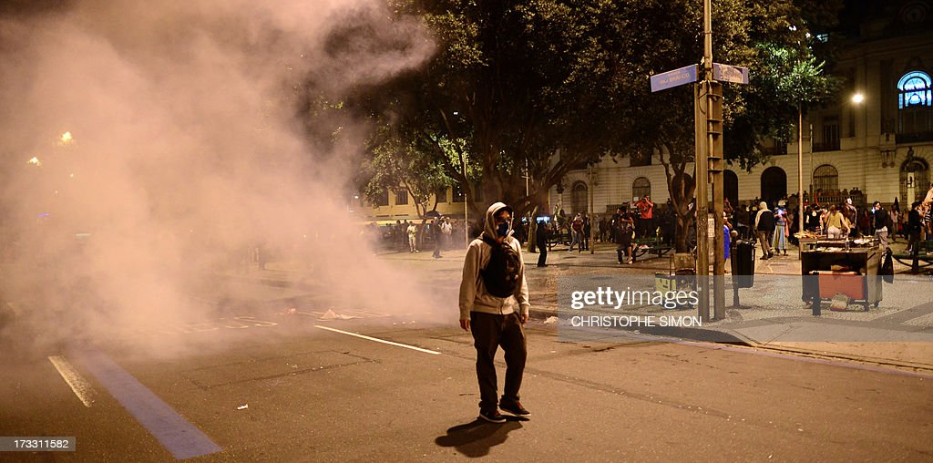 Demonstrators clash with the riot police after Brazilian workers marched in Rio de Janeiro on July 11, 2013 in a day of industrial action called by major unions to press demands for better work conditions. Demonstrators on Thursday blocked roads and staged protest rallies across the country on the 'National Day of Struggles' which was called by the country's five leading labour federations during last month's mass street protests to demand better public services and an end to endemic corruption.