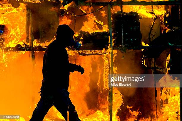 Demonstrators clashes with police during a protest against plans for new austerity measures on October 19 2011 in Athens Greece A 48hour general...