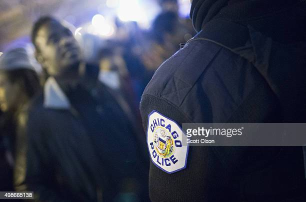 Demonstrators confront police during a protest following the release of a video showing Chicago Police officer Jason Van Dyke shooting and killing...