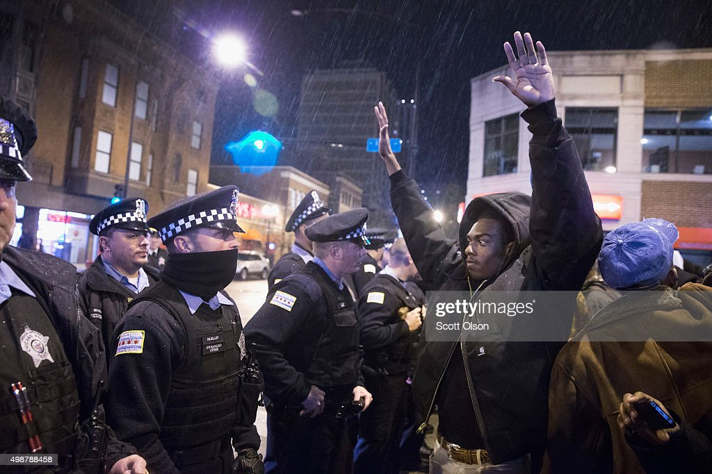 Demonstrators confront police during a protest over the death of Laquan McDonald on November 25, 2015 in Chicago, Illinois. Small and mostly peaceful protests have sprouted up around the city following yesterday's release of a video showing Chicago Police officer Jason Van Dyke shooting and killing 17-year-old McDonald. Van Dyke has been charged with first degree murder for the October 20, 2014 shooting in which McDonald was hit with 16 bullets.