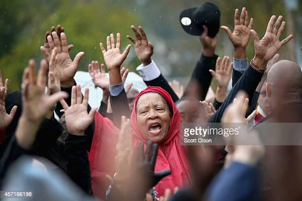 Demonstrators confront police outside the Ferguson police station on October 13 2014 in Ferguson Missouri Ferguson has been struggling to heal since...