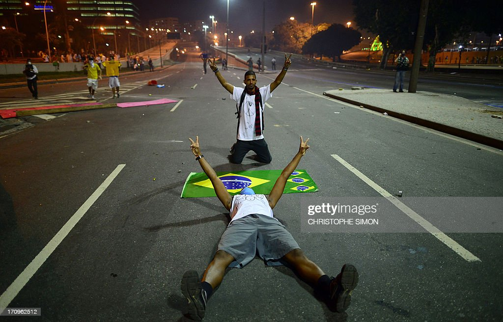 Demonstrators confront the riot police after clashes erupted during a protest against corruption and price hikes, on June 20, 2013, in Rio de Janeiro as the FIFA Confederations Cup Brazil 2013 is being held in the country. Brazilians took to the streets again Thursday in several cities on a new day of mass nationwide protests, demanding better public services and bemoaning massive spending to stage the World Cup.