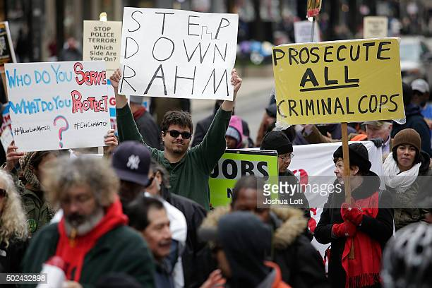 Demonstrators continue to protest the fatal police shooting of Laquan McDonald as they attempt to disrupt holiday shoppers along Michigan Avenue...