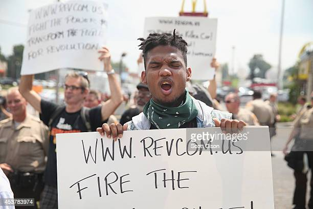 Demonstrators continue to protest the killing of teenager Michael Brown on August 18 2014 in Ferguson Missouri After a protest yesterday ended with a...