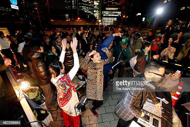 Demonstrators dance to music played by DJ Shuya Okino in front of the prime minister Shinzo Abe's official residence on January 26 2015 in Tokyo...