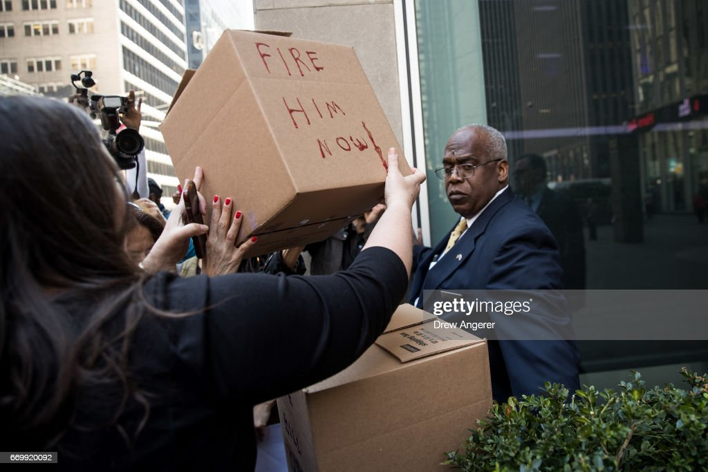 Demonstrators deliver boxes of petitions calling for the firing of Fox News television personality Bill O'Reilly to the front of the News Corp. and Fox News headquarters in Midtown Manhattan, April 18, 2017 in New York City. The protest against O'Reilly, who has been the subject of numerous sexual harassment allegations and legal settlements, was organized by the women's group UltraViolet and the New York chapter of National Organization for Women.