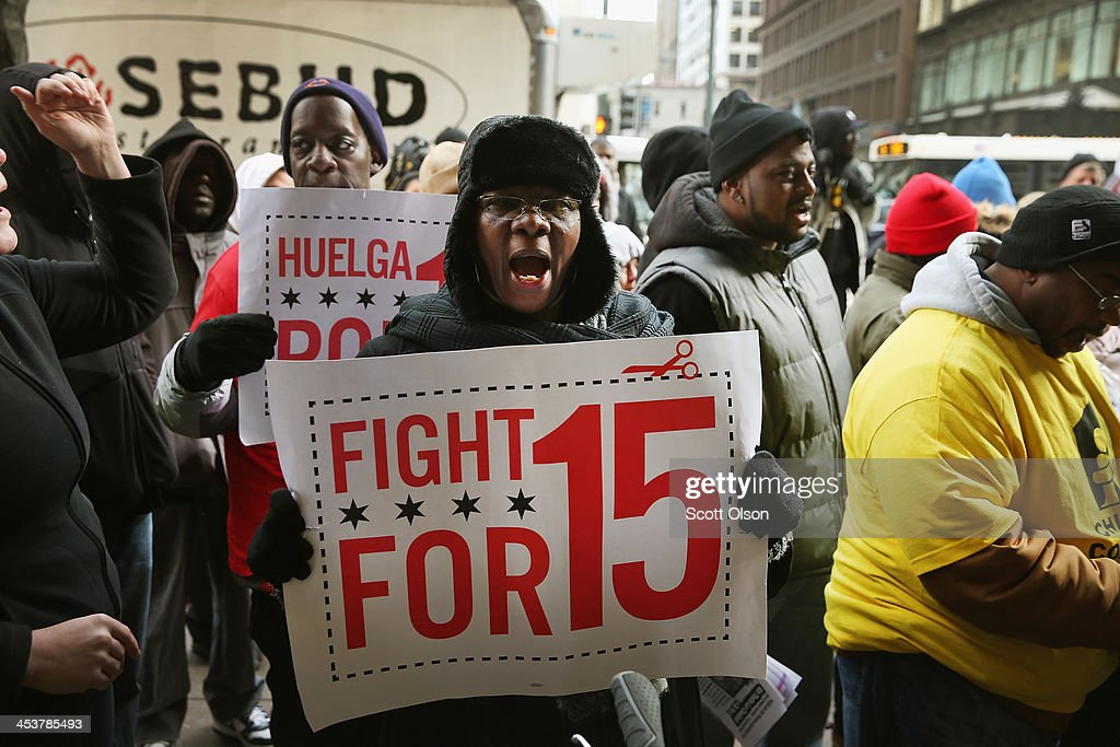 Demonstrators demanding an increase in pay for fast-food and retail workers protest outside a Sears store in the Loop on December 5, 2013 in Chicago, Illinois. Organizers have called for a one-day labor walkout at fast-food restaurants and retail stores and demonstrations in 100 cities.