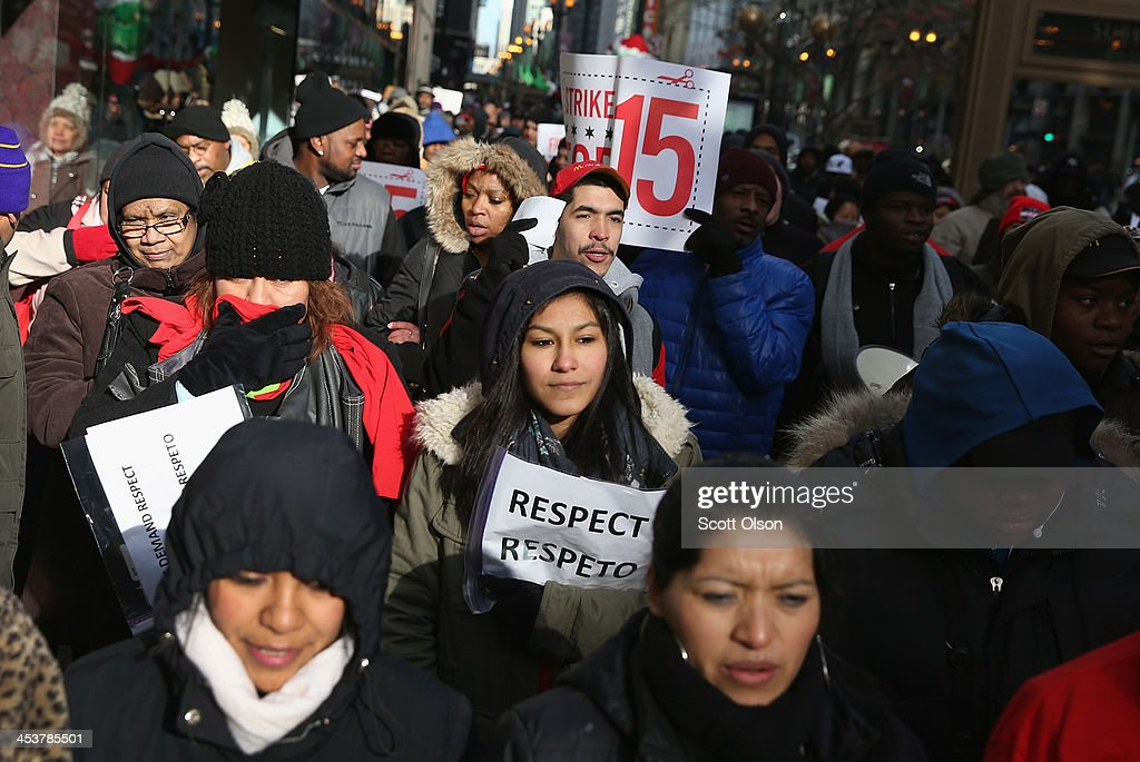Demonstrators demanding an increase in pay for fast-food and retail workers march in the Loop on December 5, 2013 in Chicago, Illinois. Organizers have called for a one-day labor walkout at fast-food restaurants and retail stores and demonstrations in 100 cities.
