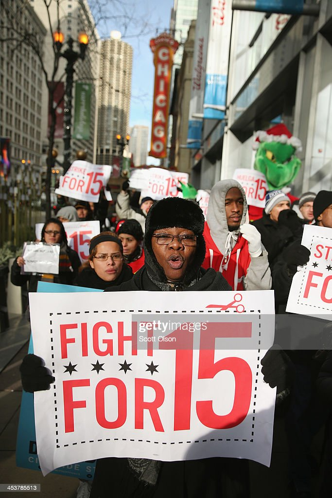 Demonstrators demanding an increase in pay for fast-food and retail workers protest in the Loop on December 5, 2013 in Chicago, Illinois. Organizers have called for a one-day labor walkout at fast-food restaurants and retail stores and demonstrations in 100 cities.