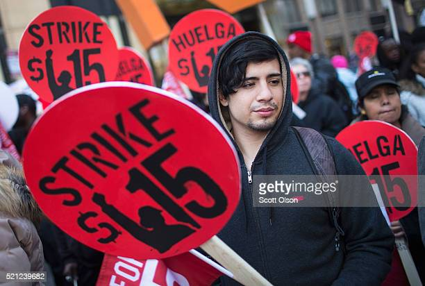 Demonstrators demanding an increase in the minimum wage to $15dollarsperhour prepare to march in the streets on April 14 2016 in Chicago Illinois The...