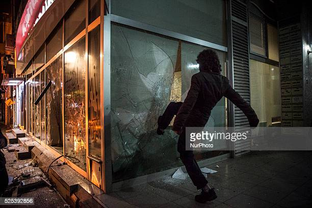 Demonstrators destroyed a bank during a protest on February 25 2014 against corruption following the release of tapped phone conversation allegedly...