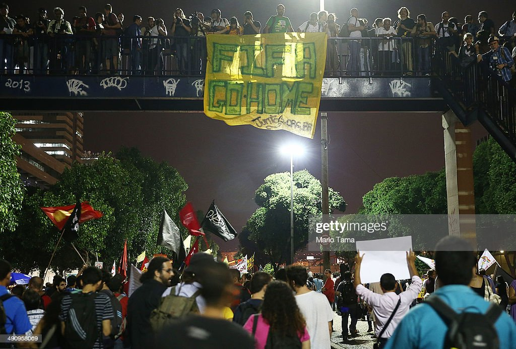 Demonstrators display a sign that reads 'FIFA Go Home' at a protest against the upcoming 2014 World Cup on May 15, 2014 in Rio de Janeiro, Brazil. Anti-World Cup demonstrations were held across the country today.
