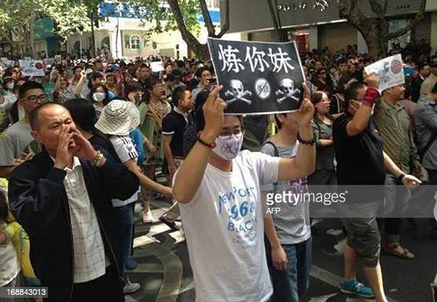 Demonstrators display banners during a protest against plans for a petrochemical plant in Kunming southwest China's Yunnan province on May 16 2013...