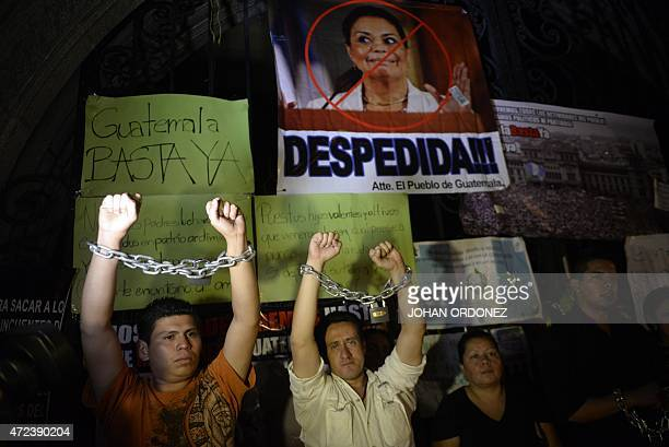 Demonstrators display chains outside the Culture Palace during a protest demanding the resignation of Guatemalan President Otto Perez Molina and Vice...